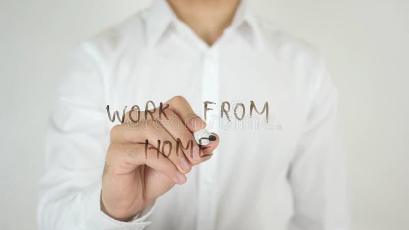 Lavoro dalla casa, scritta su vetro fotografia stock