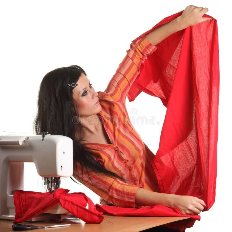 Lavoro della cucitrice sulla cucire-macchina fotografie stock libere da diritti