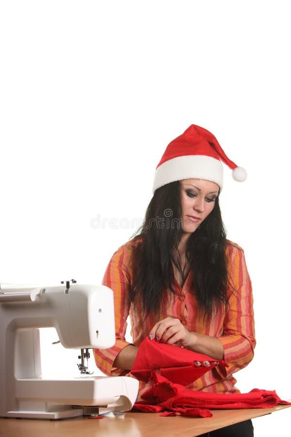 Lavoro della cucitrice sulla cucire-macchina fotografia stock