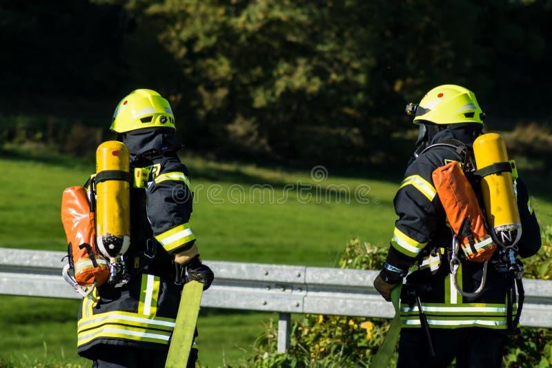 Lavoro di squadra dei vigili del fuoco in Germania fotografia stock libera da diritti