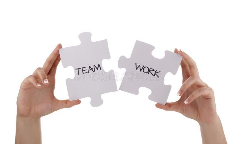 Lavoro di squadra del pezzo del puzzle immagine stock