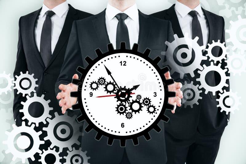Lavoro di squadra, gestione di tempo e concetto del meccanismo immagine stock