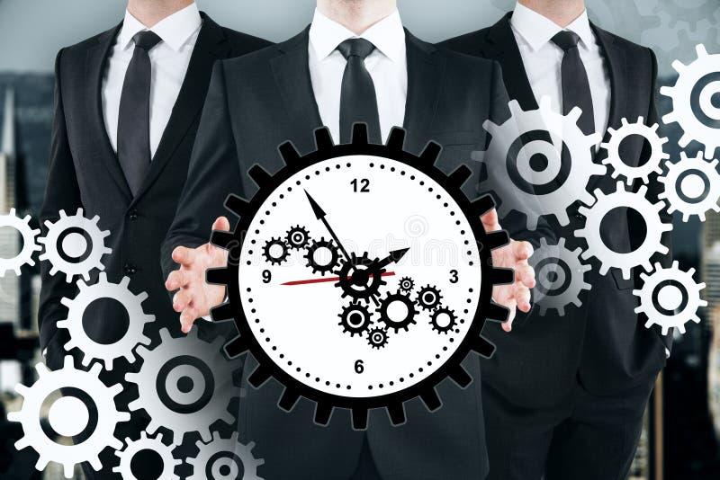 Lavoro di squadra, gestione di tempo e concetto della ruota dentata immagini stock libere da diritti