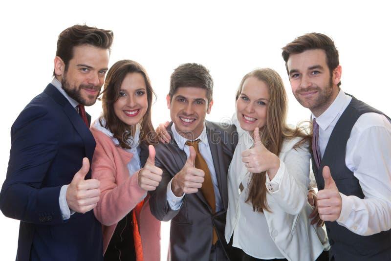 Lavoro di squadra, gruppo di affari con i pollici su fotografie stock libere da diritti