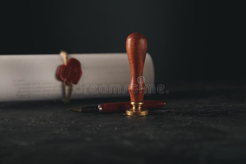 Law, attorney, notary public stamp and pen on desk. law will notary paper lawyer fountain pen seal royalty free stock photography