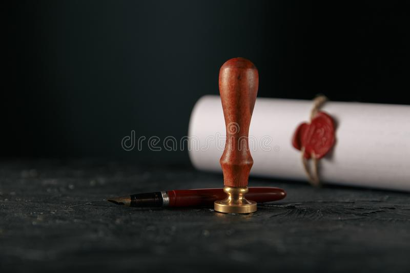 Law, attorney, notary public stamp and pen on desk. law will notary paper lawyer fountain pen seal royalty free stock images