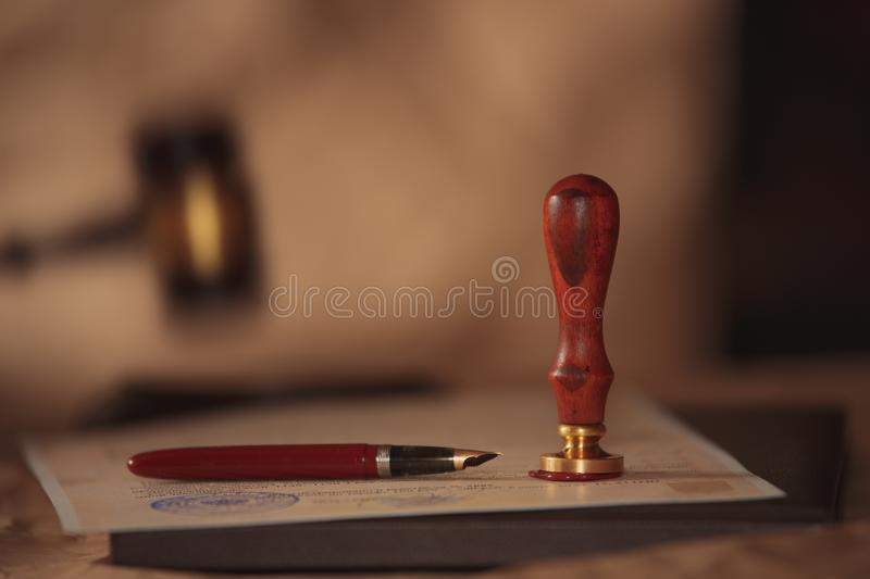 Law background theme. Fountain pen and handmade paper. law lawyer pen will notary paper legacy background concept stock photo
