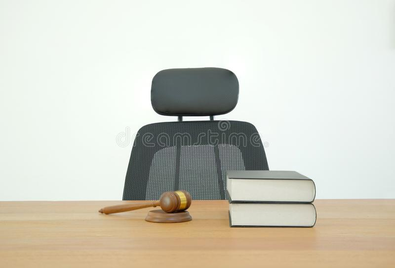 law book & judge gavel on wooden office desk. lawyer attorney justice workplace stock image