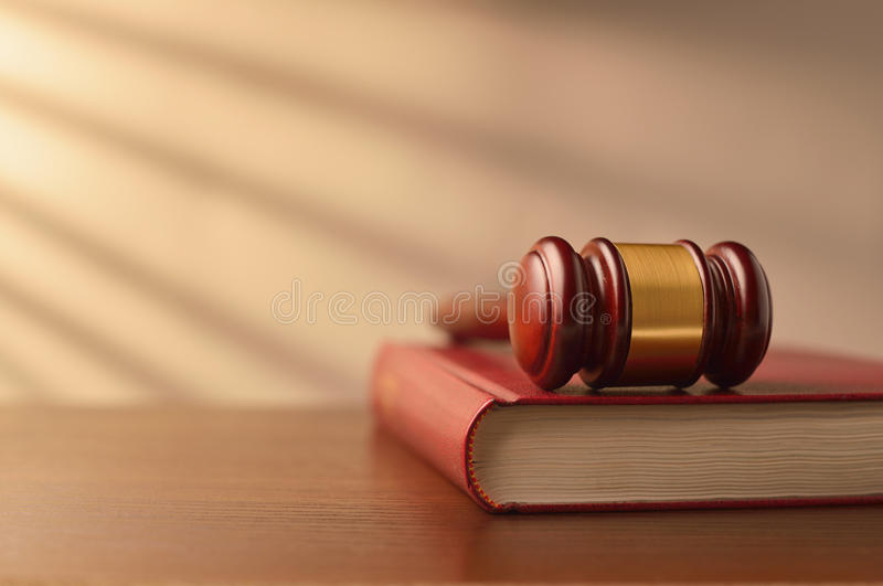 Law book and judges gavel stock photos