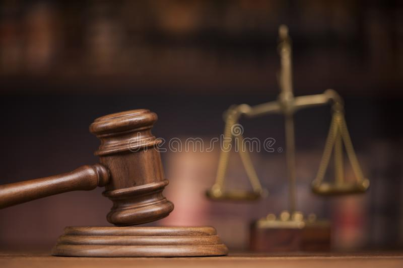 Law books, mallet of the judge, Courtroom background royalty free stock images