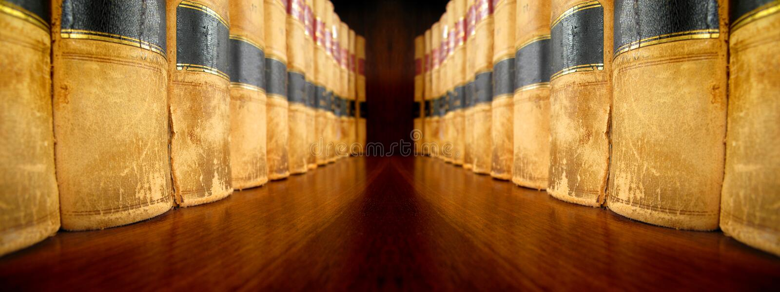 Law Books on Shelves facing each other stock photos