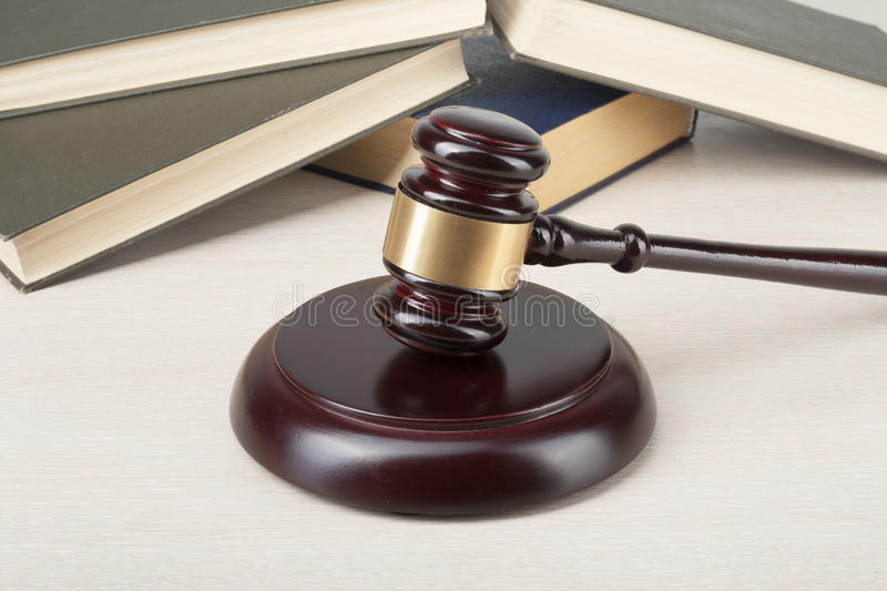 Law concept - Book with wooden judges gavel on table in a courtroom or enforcement office. Law concept - Book with wooden judges gavel on table in a courtroom stock image