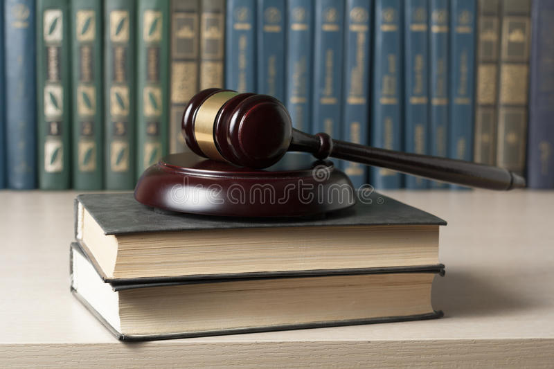 Law concept - Book with wooden judges gavel on table in a courtroom or enforcement office. Law concept - Book with wooden judges gavel on table in a courtroom stock images