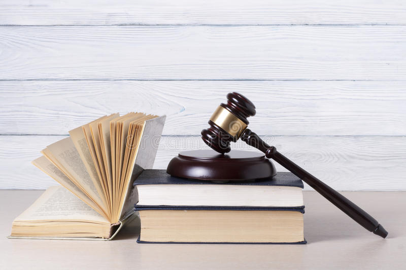 Law concept - Book with wooden judges gavel on table in a courtroom or enforcement office. Law concept - Book with wooden judges gavel on table in a courtroom stock photography