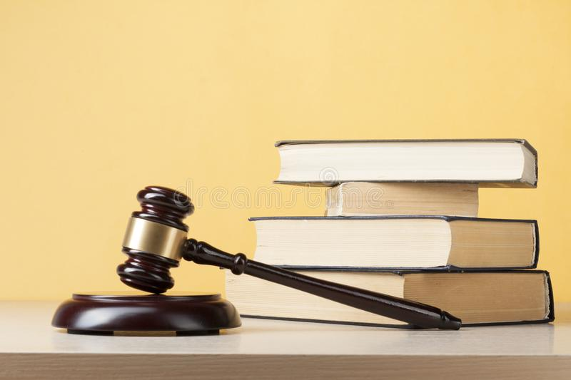 Law concept - Books with wooden judges gavel on table in a courtroom or enforcement office. Law concept - Books with wooden judges gavel on table in a courtroom royalty free stock image