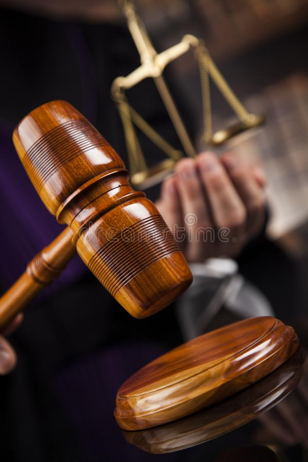 Law concept, Male judge in a courtroom striking the gavel stock photo