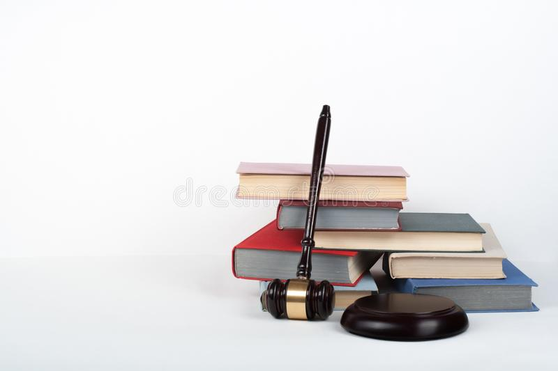 Law concept open book with wooden judges gavel on table in a courtroom or law enforcement office, white background. Copy. Space for text stock photography