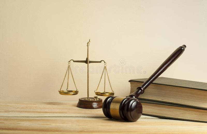 Law concept. Wooden judge gavel,scales of justice and books on table in a courtroom or enforcement office. royalty free stock photography