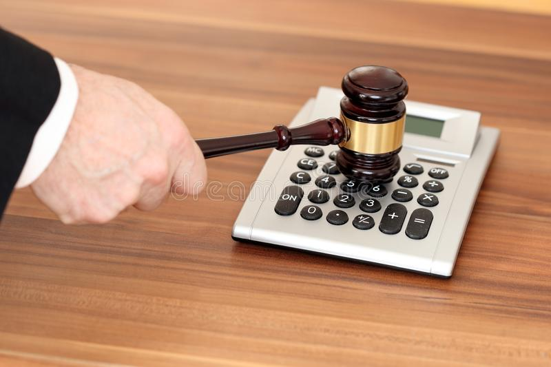 Law and decision. With a calculator on wooden table royalty free stock photo