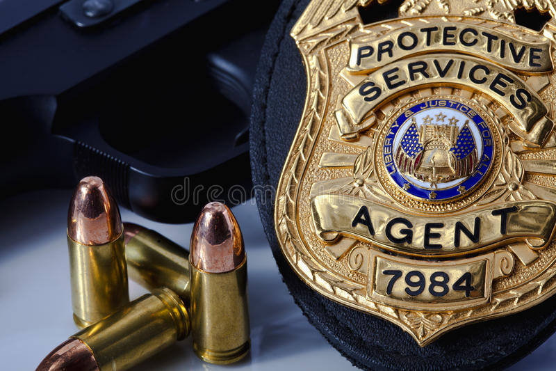 Law enforcement badge with gun, handcuffs and bullets royalty free stock images