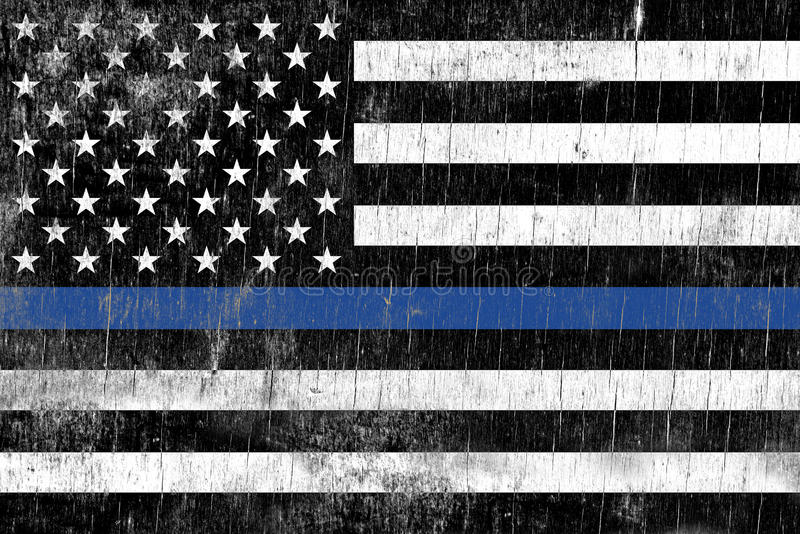 Law Enforcement Police Support Flag. A law enforcement police support flag painted over a cracking wooden texture royalty free stock image