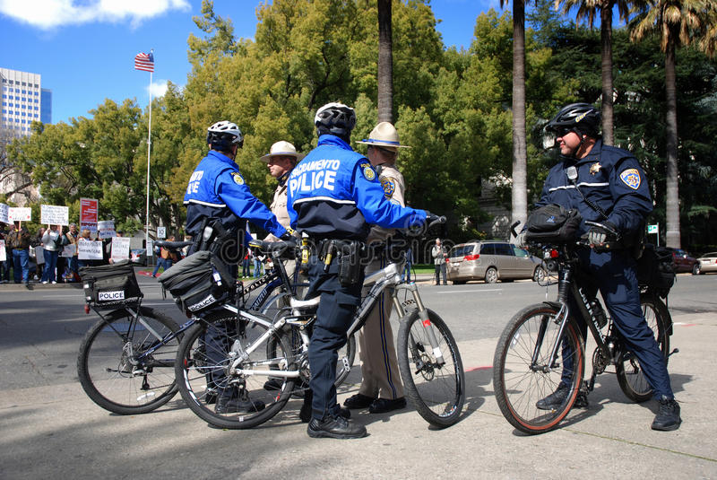 Law Enforcement at Protest. Sacramento, California, February 26, 2011: Law Enforcement officers watch Tea Party protesters in Sacramento, California, on February royalty free stock images
