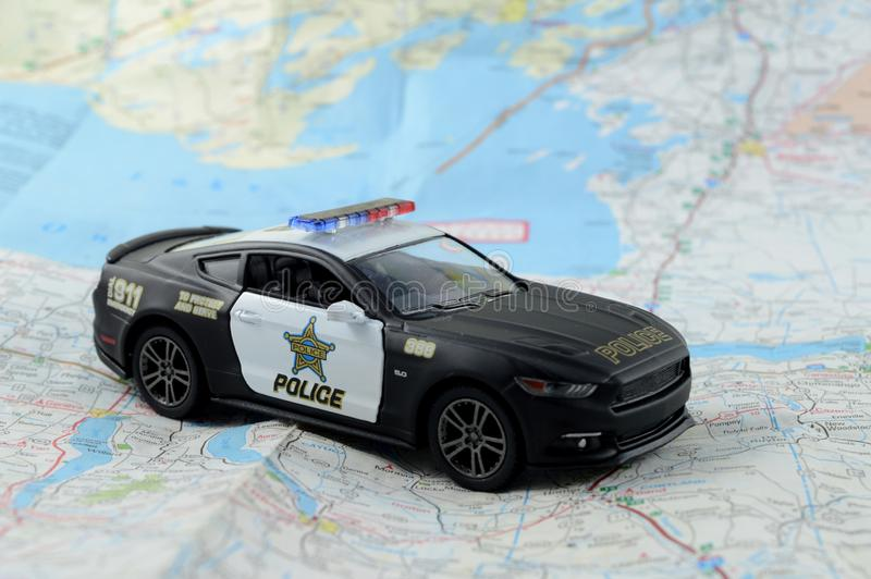 Law Enforcement Vehicle. A scale model police car resting on top of a map for several law enforcement concepts royalty free stock images