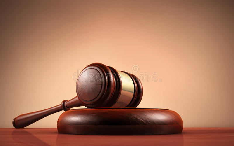 Law Judge And Justice Symbol. Judge, law, lawyer and Justice concept with a close-up 3d rendering of a gavel on a wooden desktop with dark red-brown background royalty free stock images