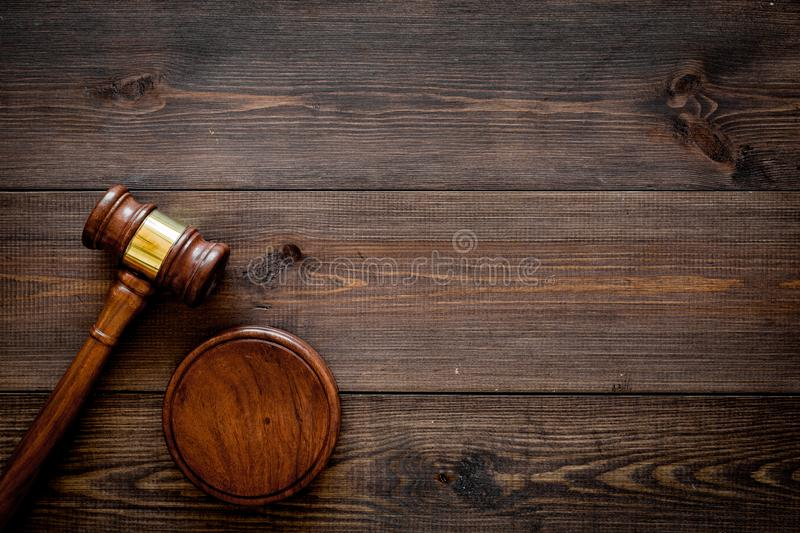 Law or jurisprudence concept. Judge gavel on dark wooden background top view copy space royalty free stock photography