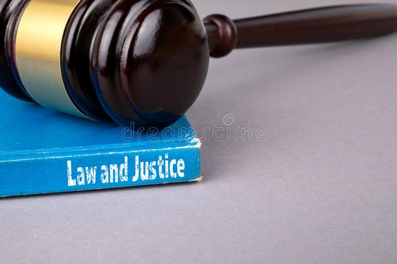 Law and justice concept. blue book on a gray office table stock photography