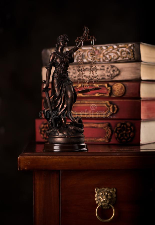 Statue Justice and books. Law and justice concept. Statue Justice and books royalty free stock photo