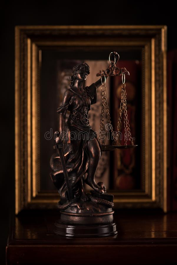 Statue Justice and books. Law and justice concept. Statue Justice and books stock image
