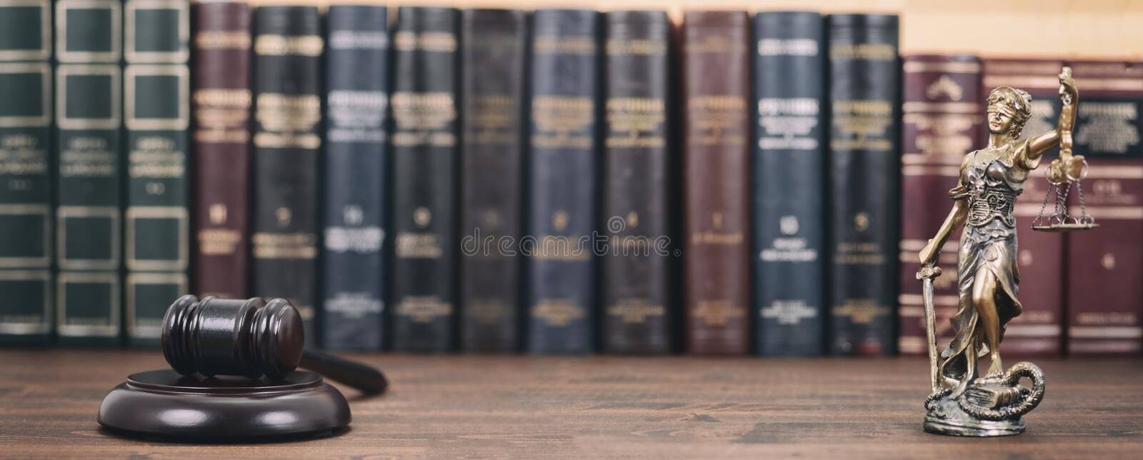 Lady Justice, Scales of Justice and Judge Gavel on a  wooden background stock photography