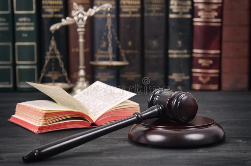 Judge Gavel , Law books and Scales of Justice on a black wooden background stock photography