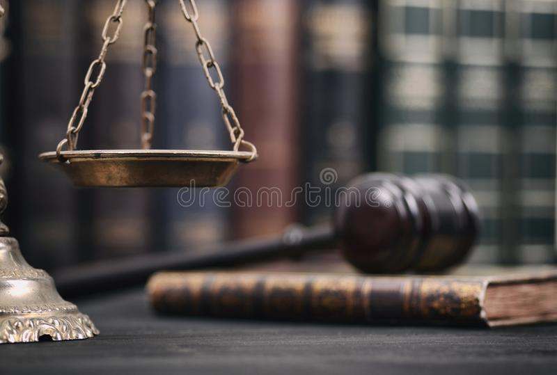 Judge Gavel , Law books and Scales of Justice on a black wooden background. royalty free stock photo
