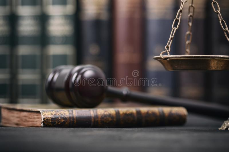 Judge Gavel , Law books and Scales of Justice on a black wooden background. stock photography