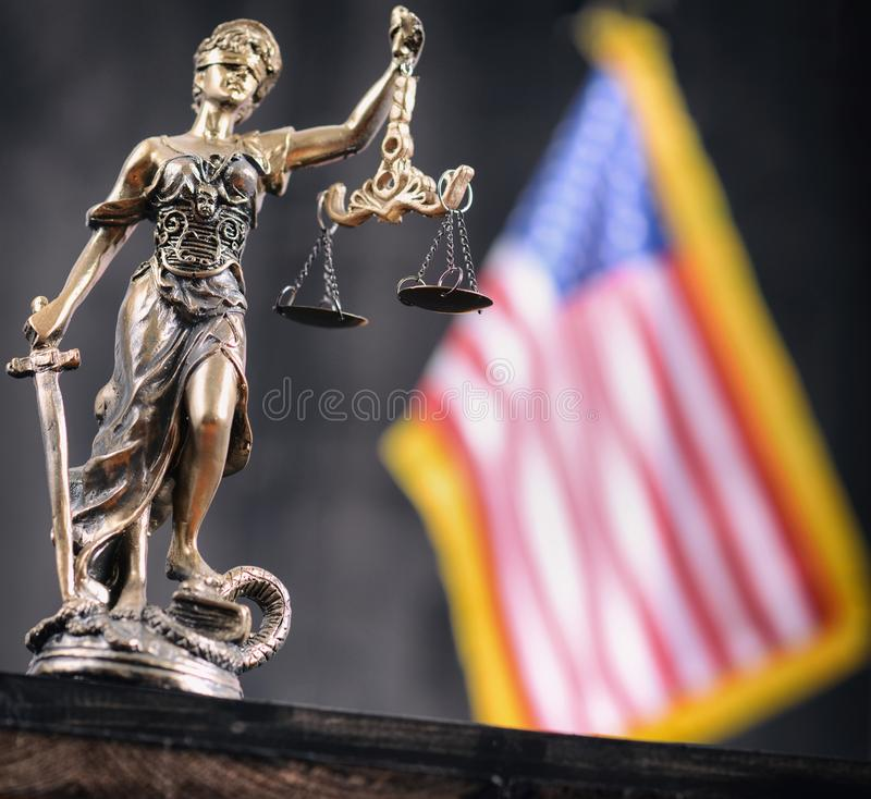 Scales of Justice, Justitia, Lady Justice in front of the American flag in the background stock images