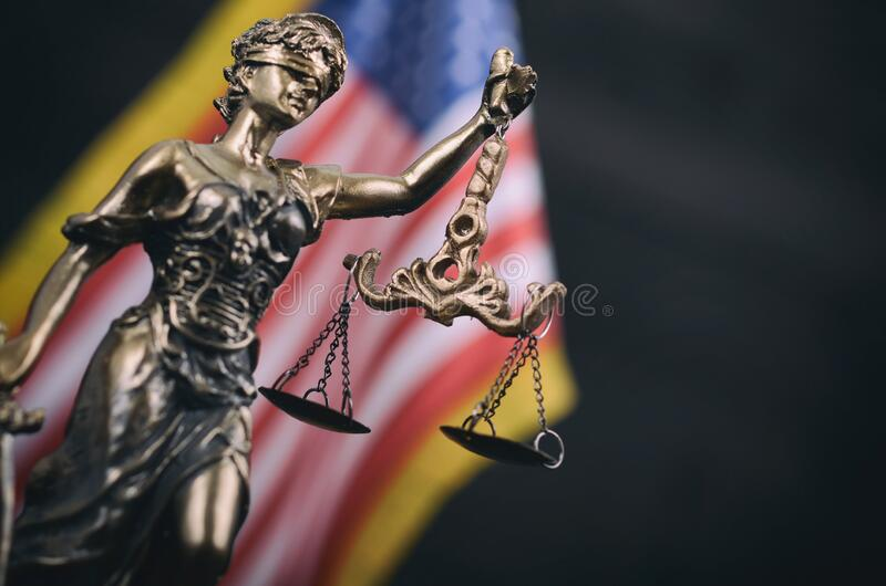 Scales of Justice, Justitia, Lady Justice in front of the American flag in the background stock image