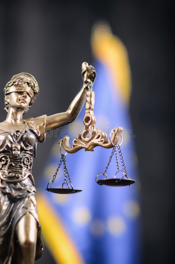 Scales of Justice, Justitia, Lady Justice in front of the European Union flag in the background stock image