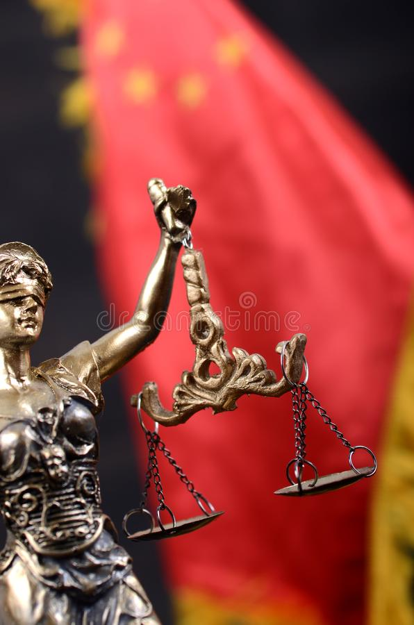 Scales of Justice, Justitia, Lady Justice in front of the flag of China. royalty free stock photos
