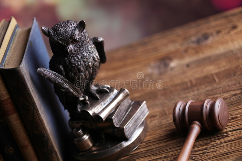 Law. And justice theme, gavel, owl and books royalty free stock photos