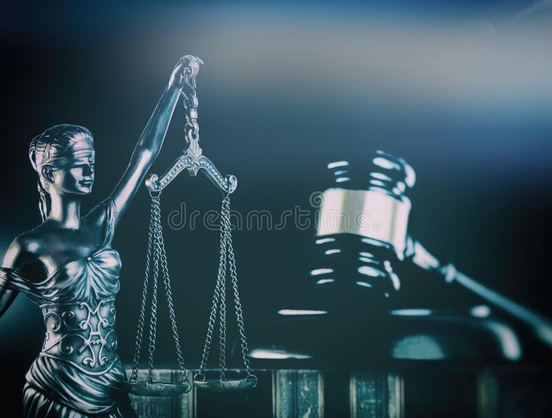 Law or law books and gavel Scales of justice background stock photo