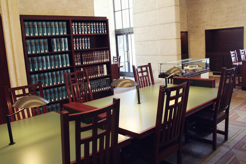 Law Library. With bookcases of law books/case books and table in the foreground stock photos