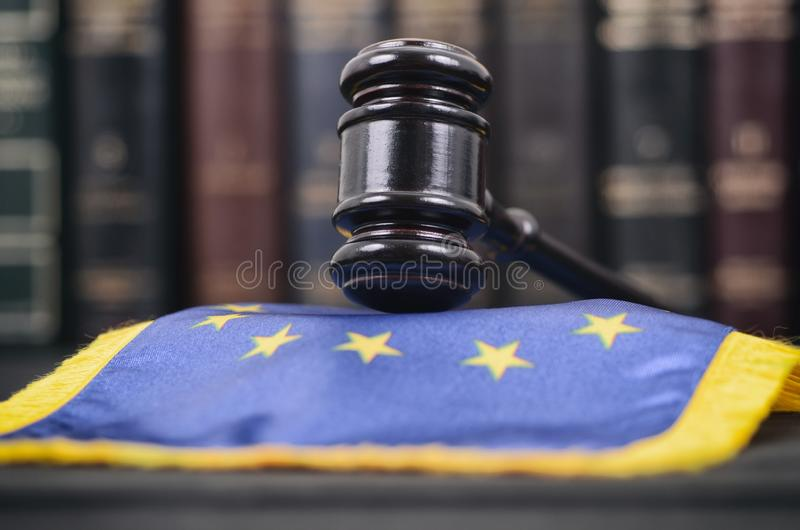 Law library, Judge Gavel and United States of America flag on a black wooden background stock photo