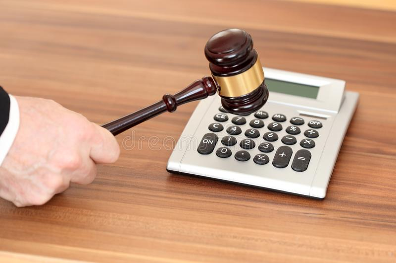 Law and order. With a calculator on wooden table royalty free stock photos
