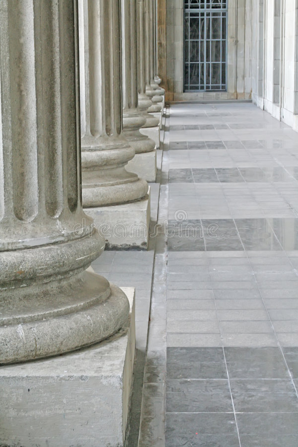 Law and order pillars outside a courthouse stock photos