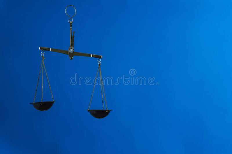 Law scales on blue background stock photo