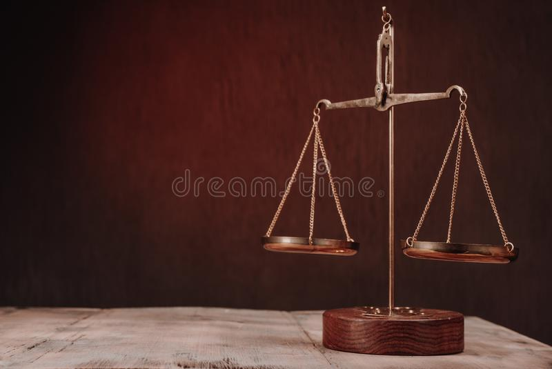 Law scales on table. Symbol of justice stock photo