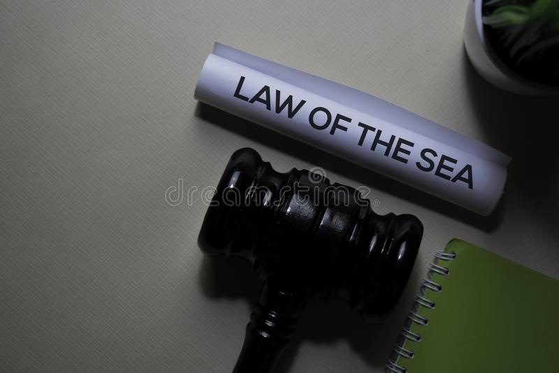 Law Of The Sea text on Document and gavel isolated on office desk. Justice law concept royalty free stock photos