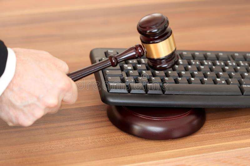 Law symbol with keyboard. And gavel on a desk royalty free stock image